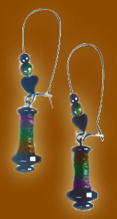 hematite bobbin earrings with handspun silk threads, long earwires and beads